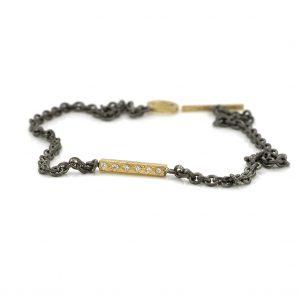 Zilveren-armband met staaje geelgoud bezet met diamanten artikel nr BE.azgd.40.12x005